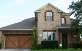 sendero-springs-round-rock-home-2-limestone-cedar-garage-door-2010