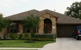 sendero-springs-round-rock-home-4-limestone-cedar-garage-door-2010