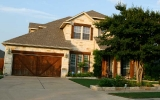 sendero-springs-round-rock-home-limestone-cedar-garage-door-2010
