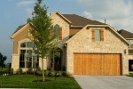 Teravista Home with Cedar Garage Door