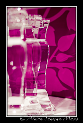 Art photo of glass candlesticks on pink to illustrate article on home condition impact on valuation