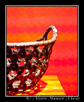 Art photo of open-weave basket on red to illustrate article on home condition impact on valuation