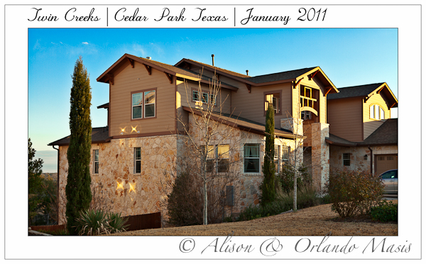 A two-story home with limestone and a view in Twin Creek in Cedar Park TX