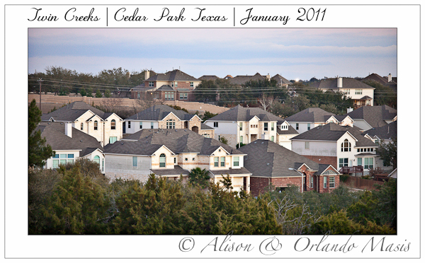 View across the tops of homes in Twin Creeks in Cedar Park