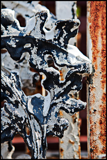 Rusty porch support at a salvage yard in Austin