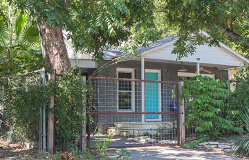 Small house with a bright blue front door in east Austin, TX